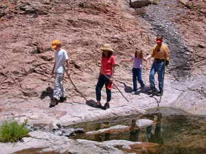 family hiking up Mineral Creek