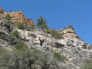 Colorful cliffs of pyroclastic white to reddish rhyolite semi-welded ash fall tuffs overlying andesite flow rocks.
