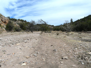 Looking east up the large intermittent stream dry wash of Little Dry Creek Canyon towards Soldier Hill in the distance, site of the ambush of Lt. Samuel Fountain and Troop C of the 34th US Calvary at Soldier Hill by the Apache Chief Ulzana and his warriors on December 19, 1885.