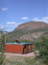 hot tub with view of turtle rock